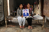 Navdeep Kaur (17) and Sandeep Kaur (13) hold a portrait of their late father, Daljit Singh, who died of tongue cancer in 2005, aged only 34. It is believed that excessive pesticide use in the region over the past 30-40 years has led to the accumulation of dangerous levels of toxins such as uranium, lead and mercury which are contributing to increased health problems including cancers, birth defects and mental disabilities in children. It's a hidden epidemic which is gripping the Punjab region in northeast India which for decades has been the country's 'bread basket'. As local farmers and their families continue to get ill they are paying the price for the country's 'Green Revolution'.