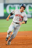 Stephen King #21 of the Hagerstown Suns rounds third base at NewBridge Bank Park July 30, 2010, in Greensboro, North Carolina.  Photo by Brian Westerholt / Four Seam Images