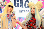 December 1st, 2013 : Tokyo, Japan - Lady Gaga, an American pop music star, posed for photographs with GAGADOLE, a dole that was made as close as her figure and could play music by hugging it, at a press conference about her new album, ARTPOP, at Roppongi Hills, Roppongi, Minato, Tokyo, Japan on December 1, 2013. (Photo by Koichiro Suzuki/AFLO)