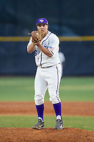 High Point Panthers starting pitcher Andre Scrubb (16) looks to his catcher for the sign against the Coastal Carolina Chanticleers at Willard Stadium on March 15, 2014 in High Point, North Carolina.  The Panthers defeated the Chanticleers 11-8 in game two of a double-header.  (Brian Westerholt/Four Seam Images)