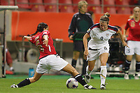 Norway defender (6) Camilla Huse goes for a tackle on USA forward (9) Heather O'Reilly. The United States (USA) defeated Norway (NOR) 4-1 during the third place match of the Women's World Cup China 2007 at Shanghai Hongkou Football Stadium in Shanghai, China, on September 30, 2007.