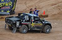 Mar. 20, 2011; Chandler, AZ, USA;  LOORRS pro two driver Rob MacCachren (left) talks with Bryce Menzies during round two at Firebird International Raceway. Mandatory Credit: Mark J. Rebilas-