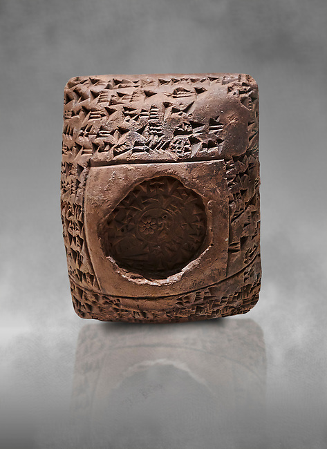 Toprak Bagis Belgesi  cuneiform donation document. Hittite Period 1600 - 1450 BC.  Hattusa Boğazkale. Çorum Archaeological Museum, Corum, Turkey. Against a grey bacground.