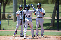 AZL Padres 2 shortstop Jordy Barley (55) is congratulated by Tucupita Marcano (1) and Payton Smith (50) after hitting a home run during an Arizona League game against the AZL Dodgers at Camelback Ranch on July 4, 2018 in Glendale, Arizona. The AZL Dodgers defeated the AZL Padres 2 9-8. (Zachary Lucy/Four Seam Images)