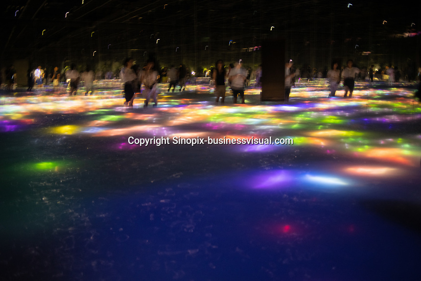 "The immersive installation in Team Lab Planets, constits of water with reflections of moving fish and flowers in Tokyo, Japan. It is called ""<br /> Drawing on the Water Surface Created by the Dance of Koi and People """