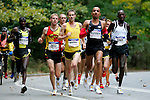 A pack of runners head through Central Park in the 2008 Men's Olympic Trials Marathon on November 3, 2007 in New York, New York.  The race began at 50th Street and Fifth Avenue and finished in Central Park.  Ryan Hall won the race with a time of 2:09:02.