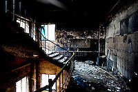 The burned stairway that workers tried to escape through when the fire broke out. At least 112 people died, and more than 100 were injured at a fire at the Tazreen Fashions textile factory in Dhaka. Bangladesh's garment industry has a notoriously bad fire safety record; if the right precautions had been taken, the fire could have been prevented.