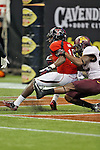 Texas Tech Red Raiders wide receiver Darrin Moore (14) in action during the Meineke Car Care Bowl game of Texas between the Texas Tech Red Raiders and the Minnesota Golden Gophers at the Reliant Stadium in Houston, Texas. Texas defeats Minnesota 34 to 31.