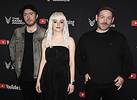 LOS ANGELES- DECEMBER 12: Martin Doherty, Lauren Mayberry and Lain Cook of Chvurches attend the Game Awards 2019 at the Microsoft Theater on December 12, 2019 in Los Angeles, California. (Photo by Scott Kirkland/PictureGroup)