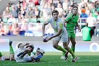 Tom Mitchell of England passes as Ed Jenkins of Australia looks on during the iRB Marriott London Sevens at Twickenham on Sunday 13th May 2012 (Photo by Rob Munro)
