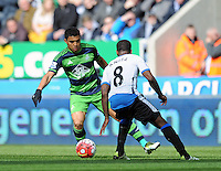 Jefferson Montero of Swansea City (left) tries to get the ball past Vurnon Anita of Newcastle United during the Barclays Premier League match between Newcastle United and Swansea City played at St. James' Park, Newcastle upon Tyne, on the 16th April 2016