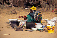 Akadaney, Central Niger, West Africa.  Woman Preparing Food for Sale at Annual Fulani Gathering, Geerewol.