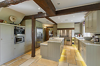 BNPS.co.uk (01202) 558833. <br /> Pic: Savills/BNPS<br /> <br /> Pictured: Kitchen.  <br /> <br /> A wheely rare opportunity...<br /> <br /> A grand country manor with a 300-year-old donkey wheel is on the market for £4.95m.<br /> <br /> The donkey wheel at Annables Manor, one of only two still in existence in England, was built in the 17th century and used to draw water from the 145ft well.<br /> <br /> The Grade II listed manor house near Harpenden, Herts, is one of the finest country houses in the area and as well as its unusual historic feature it has a heated swimming pool and tennis court in its 5.34 acres of land.<br /> <br /> The seven-bedroom home has lots of impressive features including oak beams, open fireplaces and solid oak floors.