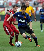 Manchester United midfielder Ji-Sung Park (13) dribbles around Chicago Fire midfielder Daniel Paladini (11).  Manchester United defeated the Chicago Fire 3-1 at Soldier Field in Chicago, IL on July 23, 2011.
