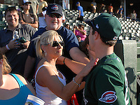 Outfielder Bryce Brentz (25) of the Greenville Drive gets a hug and pat from his mother with his father (in hat) watching after he extended his hitting streak to 26 games against the Charleston RiverDogs on May 15, 2011, at Fluor Field at the West End in Greenville, S.C. Photo by Tom Priddy / Four Seam Images