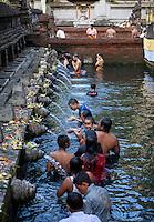 Bali, Indonesia.  Worshipers Bathing at Tirta Empul, a Spring Sacred to Balinese Hindus.