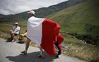 polish fan 'surfing' up the Col de Glandon (HC/1924m/21.7km@5.1%)<br /> <br /> stage 18: Gap - St-Jean-de-Maurienne (187km)<br /> 2015 Tour de France