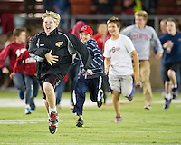 STANFORD, CA - April 14, 2012: Kids Running the Field after the Stanford Cardinal vs San Jose St. game at Stanford Stadium at Sanford, CA. Final score Stanford 20, San Jose St. 17.