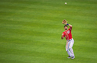28 July 2013: Washington Nationals infielder Stephen Lombardozzi pulls in a fly ball during a game against the New York Mets at Nationals Park in Washington, DC. The Nationals defeated the Mets 14-1. Mandatory Credit: Ed Wolfstein Photo *** RAW (NEF) Image File Available ***