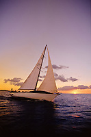 Sailboat, sailing at Sunset in the Rock Islands of Palau, Micronesia.  Property Release.  Model Release.
