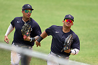 New York Yankees outfielder Jasson Dominguez (25) races ahead of Everson Pereira on the way to the dugout at the end of an Extended Spring Training game against the Detroit Tigers on June 19, 2021 at the Joker Marchant Stadium in Lakeland, Florida.  (Mike Janes/Four Seam Images)