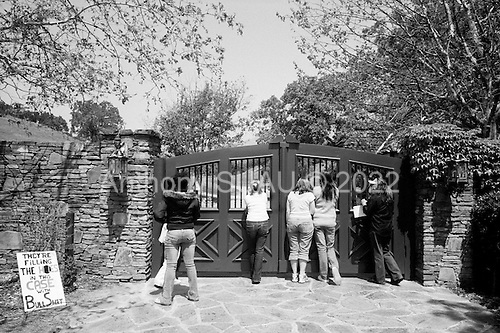 Santa Ynez Valley, California.USA.April 2005..Supporters and fans of pop singer Michael Jackson outside the gates of Mr. Jackson's Neverland ranch in Santa Ynez Valley. They are there to support him in his trial for child abuse. .Mr. Jackson, 46, denies all 10 charges against him, including child abuse. He faces up to 20 years in jail if convicted on all charges.