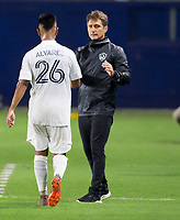 CARSON, CA - SEPTEMBER 19: Head coach of the the Los Angeles Galaxy greets Efrain Alvarez #26 as he departs the field of play during a game between Colorado Rapids and Los Angeles Galaxy at Dignity Heath Sports Park on September 19, 2020 in Carson, California.