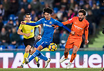 Gaku Shibasaki (L) of Getafe CF fights for the ball with Juan Carlos Perez Lopez, Juankar, of Malaga CF during the La Liga 2017-18 match between Getafe CF and Malaga CF at Coliseum Alfonso Perez on 12 January 2018 in Getafe, Spain. Photo by Diego Gonzalez / Power Sport Images