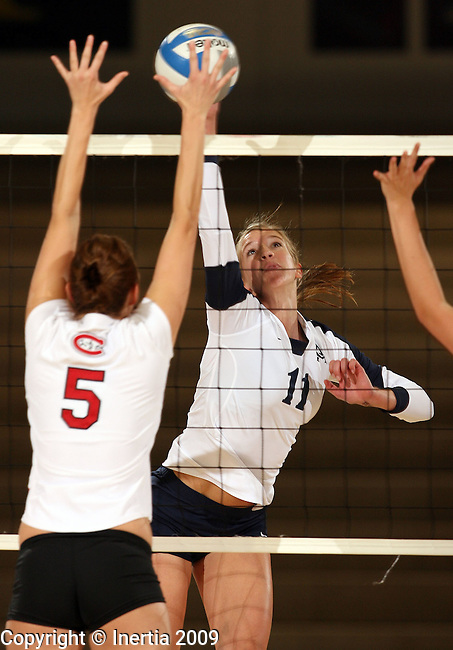 SIOUX FALLS, SD - SEPTEMBER 29:  Brianna Erickson #11 of Augustana tips the ball past Kristen Stott #5 of St. Cloud State University in the first game of their match Tuesday night at the Elmen Center. (Photo by Dave Eggen/Inertia).