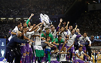 Calcio, Champions League: finale Juventus vs Real Madrid. Cardiff, Millennium Stadium, 3 giugno 2017.<br /> Real Madrid's Sergio Ramos holds up the trophy at the end of the Champions League final match between Juventus and Real Madrid at Cardiff's Millennium Stadium, Wales, June 3, 2017. Real Madrid won 4-1.<br /> UPDATE IMAGES PRESS/Isabella Bonotto