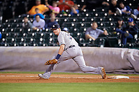 Colorado Springs Sky Sox first baseman Garrett Cooper (30) stretches to try to receive a throw during a game against the Oklahoma City Dodgers on June 2, 2017 at Chickasaw Bricktown Ballpark in Oklahoma City, Oklahoma.  Colorado Springs defeated Oklahoma City 1-0 in ten innings.  (Mike Janes/Four Seam Images)
