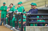 Notre Dame Fighting Irish head coach Mik Aoki watches from the dugout during the game against the Wake Forest Demon Deacons at David F. Couch Ballpark on March 10, 2019 in  Winston-Salem, North Carolina. The Fighting Irish defeated the Demon Deacons 8-7 in 10 innings in game two of a double-header. (Brian Westerholt/Four Seam Images)