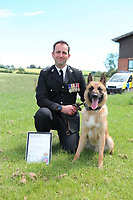 """Pictured: PC Michael Barnsley<br /> Re: Two police dog handlers have been commended for saving the life of a missing woman in Ceredigion.<br /> Dyfed-Powys Police offices PC Spencer Cowper and PC Michael Barnsley gave vital first aid to the woman who was found with a severe cut to her abdomen and was losing blood rapidly.<br /> The force had received a missing person report at around 7.15pm on Monday, November 2, and search enquiries were immediately commenced.<br /> Chief Inspector Christina Fraser said: """"An officer was sent to her home and other units dispatched to search the surrounding area, but we were facing a difficult task as we were aware she had taken her car, but we didn't know which direction she had driven in.<br /> """"Her phone was switched off so no contact could be made with her to check that she was ok, or to find out where she had gone.<br /> """"Around an hour-and-a-half after we began our search, she phoned a family member and indicated where she was.""""<br /> Fortunately, four police officers were close by and found the missing woman in her car. She was unconscious, but breathing, and the officers quickly noticed blood stains on her clothes.<br /> Ch Insp Fraser said: """"Two of our dog handlers – PC Barnsley and PC Cowper – quickly lifted her out of the car and found that the source of the blood was a deep, six-inch wound on her abdomen.<br /> """"The officers' colleagues immediately updated the ambulance service, but there was no time to lose as she was losing blood quickly.<br /> """"PCs Barnsley and Cowper started administering first aid to stem the bleeding, and there is no doubt that their actions at this point saved her life.""""<br /> Paramedics arrived at the scene at 9.20pm, and after stabilising the woman she was flown to hospital by the air ambulance.<br /> """"I have to commend the commitment and professionalism of the officers at the scene, who administered first aid and liaised with ambulance control to ensure a positive outcome,"""" Ch Insp said.<br /> """""""