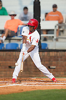 Magneuris Sierra (37) of the Johnson City Cardinals makes contact with the baseball against the Bristol Pirates at Howard Johnson Field at Cardinal Park on July 6, 2015 in Johnson City, Tennessee.  The Pirates defeated the Cardinals 2-0 in game one of a double-header. (Brian Westerholt/Four Seam Images)