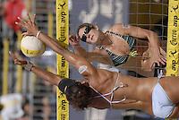 Huntington Beach, CA - 5/5/07:   Nicole Branagh spikes the ball during Branagh / Youngs'  19-21, 21-15, 15-7 victory over Dodd / Tati Saturday during the 2007 AVP CROCS Tour in Huntington Beach..Photo by Carlos Delgado