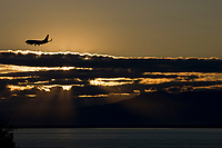 Alaska Airlines jet and summer sunset over Sleeping Lady mountain in Cook Inlet adjacent to Anchorage, Alaska, southcentral.