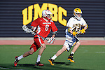 Baltimore, MD - March 3: Defensemen Ian Gray #42 of the UMBC Retrievers  defends Midfielder Brent Adams #8 of the Fairfield Stags during the Fairfield v UMBC mens lacrosse game at UMBC Stadium on March 3, 2012 in Baltimore, MD.
