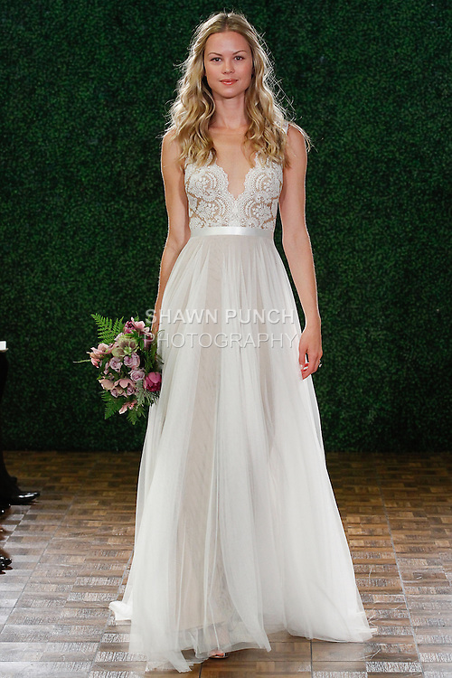 Model walks runway in a bridal gown from the Watters Brides Fall 2014 collection, by Vatana Watters, at the Couture Show during New York Bridal Fashion Week, April 12, 2014.