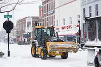 A crew member from the Bentonville Water Departmentplows snow, Monday, February 15, 2021 along the sidewalks on Main Street near the Square in Bentonville. Check out nwaonline.com/210216Daily/ for today's photo gallery. <br /> (NWA Democrat-Gazette/Charlie Kaijo)