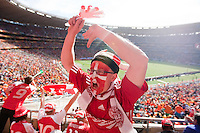 Denmark supporter Jakob V. Kristensen urges other Danish fans to stand up an  cheer during the first half of the FIFA World Cup first round match between Holland and Denmark at Soccer City in Johannesburg, South Africa on Friday, June 11, 2010.
