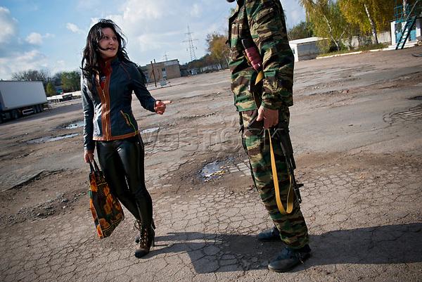 Tanya, Scharfschuetzin der pro-russischen Separatisten, Portrait, Donezk, Ukraine, 10.2014,  Tanya, 19-years old girl, the sniper of the pro-Russian militia smokes at the military base at the suburb of Donetsk.  ***HIGHRES AUF ANFRAGE*** ***VOE NUR NACH RUECKSPRACHE***