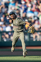 Vanderbilt Commodores third baseman Austin Martin (16) makes a running throw towards first base against the Michigan Wolverines during Game 1 of the NCAA College World Series Finals on June 24, 2019 at TD Ameritrade Park in Omaha, Nebraska. Michigan defeated Vanderbilt 7-4. (Andrew Woolley/Four Seam Images)