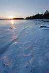 Winter sunset on frozen West Pond Cove on Schoodic Peninsula in Acadia National Park, Maine, USA