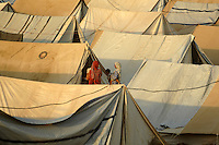 Refugees from Swat district shelter in the Swabi Refugee camp. The camp is run by Red Cross/Red Crescent (ICRC), and currently houses around 18,000 refugees. The Pakistani government began an offensive against the Taliban in the Swat Valley in April 2009, which led to a major humanitarian crisis. Up to two million civilians were estimated to have been displaced by the fighting.