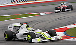 04 Apr 2009, Kuala Lumpur, Malaysia --- Brawn GP Formula 1 Team driver Jenson Button of Great Britain steers his car followed by Panasonic Toyota Racing driver Timo Glock of Germany during the third practice session ahead the 2009 Fia Formula One Malasyan Grand Prix at the Sepang circuit near Kuala Lumpur. Photo by Victor Fraile --- Image by © Victor Fraile / The Power of Sport Images