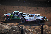 Dec. 10, 2011; Chandler, AZ, USA;  LOORRS pro 4 unlimited driver Johnny Greaves (12) and Carl Renezeder (17) during round 15 at Firebird International Raceway. Mandatory Credit: Mark J. Rebilas-