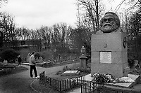 England. London. Visitors at the grave of Karl Marx in Highgate cemetery (East Cemetery). Highgate Cemetery is a place of burial in north London. It is divided into two parts, named the East and West cemetery. Karl Marx (5 May 1818 – 14 March 1883) was a Prussian-born philosopher, economist, political theorist, sociologist, journalist, and revolutionary socialist. Born in Trier to a middle-class family, he later studied political economy and Hegelian philosophy. As an adult, Marx became stateless and spent much of his life in London, England, where he continued to develop his thought in collaboration with German thinker Friedrich Engels and published various works, the most well-known being the 1848 pamphlet The Communist Manifesto. His work has since influenced subsequent intellectual, economic, and political history. The most famous burial in the Highgate cemetery (East Cemetery) is arguably that of Karl Marx, whose tomb was the site of attempted bombings on 2 September 1965 and in 1970. London is the capital and most populous city of England and the United Kingdom. 22.3.1997 © 1997 Didier Ruef