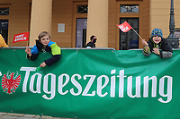 20th April 2021; Cycling Tour of the Alps Stage 2, Innsbruck, Feichten Im Kaunertal Austria Apr 20th; Interested children from Austria in front of Tageszeitung banner.