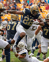 Pitt running back Darrin Hall (22) tries to hurdle a Georgia Tech defender. The Pitt Panthers football team defeated the Georgia Tech Yellow Jackets 24-19 on September 15, 2018 at Heinz Field in Pittsburgh, Pennsylvania.