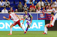 Harrison, NJ - Wednesday Aug. 03, 2016: Aurelien Collin, Hessler Archila during a CONCACAF Champions League match between the New York Red Bulls and Antigua at Red Bull Arena.